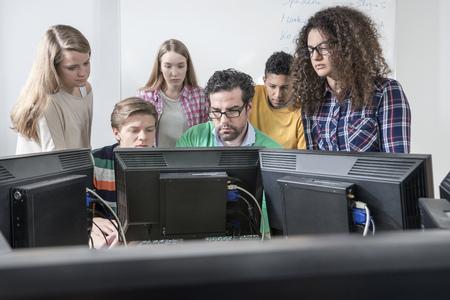 german ethnicity: Teacher teaching students in computer lab, Bavaria, Germany