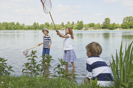 german ethnicity: Three friends fishing in the lake, Bavaria, Germany LANG_EVOIMAGES