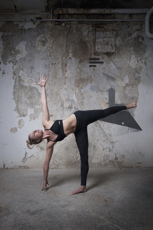 ardha: Mid adult woman practicing half moon pose in yoga studio, Munich, Bavaria, Germany
