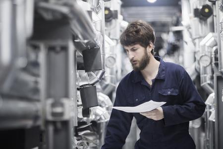freiburg: Young male engineer working in an industrial plant, Freiburg im Breisgau, Baden-Württemberg, Germany