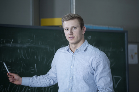 freiburg: Young student as tutor explaining on blackboard in lecture hall, Freiburg im Breisgau, Baden-Württemberg, Germany