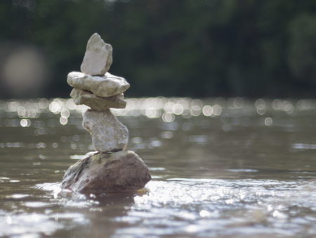 Close-up of stack of rocks balancing in Isar river, Bavaria, Germany