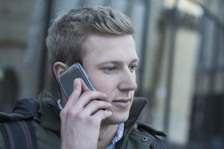 freiburg: College student talking on a mobile phone, Freiburg im Breisgau, Baden-Württemberg, Germany