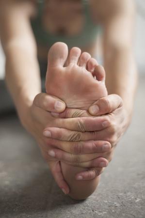 janu: Woman practicing janu sirsasana pose in yoga studio, Munich, Bavaria, Germany