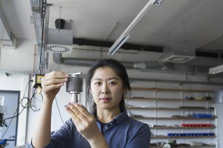 german ethnicity: Young female engineer working in an industrial plant, Freiburg im Breisgau, Baden-Württemberg, Germany