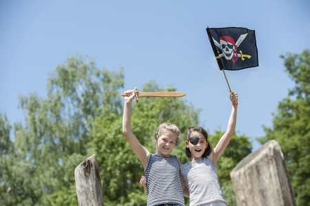 Two girls playing on pirate ship in adventure playground, Bavaria, Germany LANG_EVOIMAGES