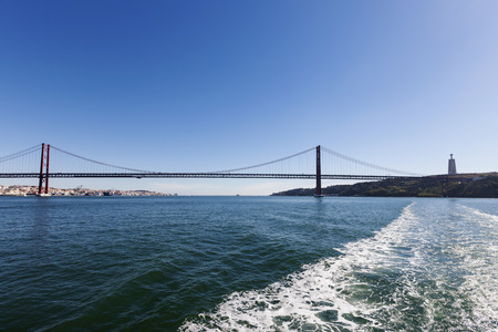 Bridge across river, April 25th Bridge, River Tagus, Lisbon, Portugal LANG_EVOIMAGES