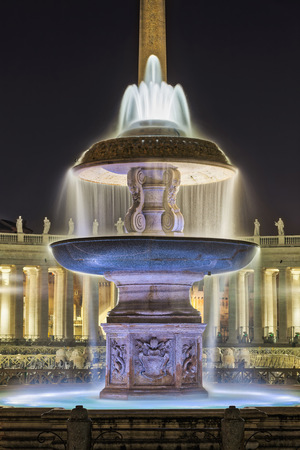Fountain with cathedral at St Peter Square, Rome, Italy
