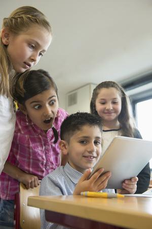 german ethnicity: School children using a digital tablet in a classroom, Munich, Bavaria, Germany,