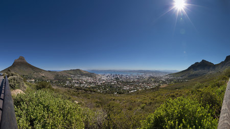 table mountain national park: Aerial view of city against blue sky, Cape Town, South Africa