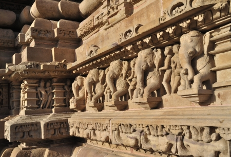 Elephant sculptures on the wall, at Vishvanatha Temple, Western temples of Khajuraho, Madhya Pradesh, India photo