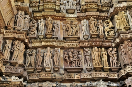 Human Sculptures at wall of Western temples of Khajuraho, Madhyapradesh, India  Фото со стока