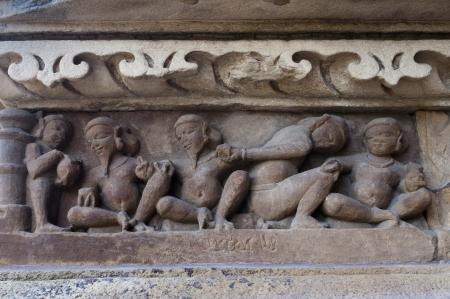 domestic life: Human Sculptors made of stone depicting domestic life, at Vishvanatha Temple Stock Photo