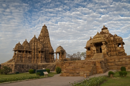 Kandariya Mahadeva Temple, dedicated to Shiva - left side and Debi Jagdambi Temple, dedicated to Parvati,  Western Temples of Khajuraho, Madya Pradesh, India photo