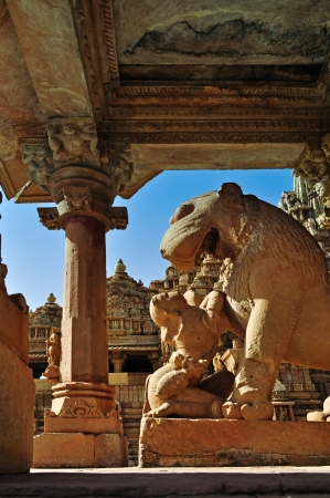Apsara worshipping lion, symbolzing power, Khajuraho, India, UNESCO world heritage site  photo