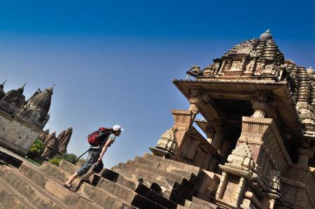 lord vishnu: Khajuraho, Madhya Pradesh , India - March 2011    Foreign visitor at Vishvanatha Temple, dedicated to Lord Vishnu, Western Temples of Khajuraho on 21st March, 2011  Khajuraho is an UNESCO world heritage site, a popular tourist destination from all over th
