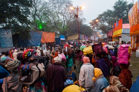 BABUGHAT, KOLKATA, WEST BENGAL   INDIA - 9TH JANUARY 2013   Hindu devotees on 9th January, 2013 in Babughat transit Camp, Kolkata  They are on their way to Gangasagar  Sagar    Stock Photo - 24453956