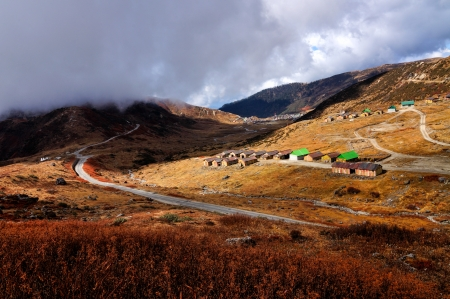 Nathang valley under clouds, interesting play of light and shadow, Sikkim, India photo