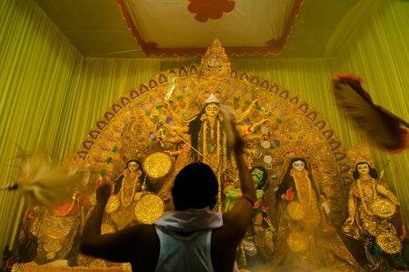 KOLKATA , INDIA - OCTOBER 11, 2013   Priest praying to Goddesss Durga, Durga Puja festival celebration  It is the biggest religious festival of Hinduism and local Bengali Community