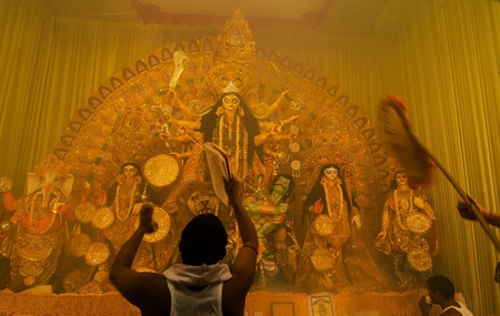 KOLKATA , INDIA - OCTOBER 11, 2013   Priest praying to Goddesss Durga, Durga Puja festival celebration  It is the biggest religious festival of Hinduism and local Bengali Community