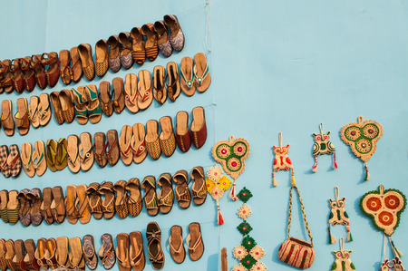 KOLKATA, WEST BENGAL , INDIA - DECEMBER 14TH 2013   Artworks of shoes and handicraft, on display during the Handicraft Fair in Kolkata - the biggest handicrafts fair in Asia