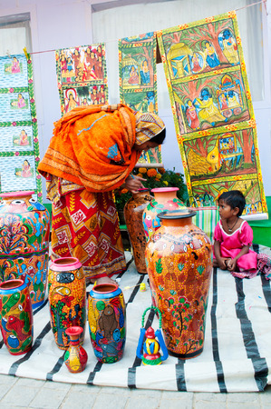 KOLKATA, WEST BENGAL , INDIA - DECEMBER 14TH 2013   Unidentified woman making wicker baskets , handicrafts on display at Handicraft Fair in Kolkata - the biggest handicrafts fair in Asia