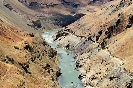 ladakh: Zanskar river flowing through rocks of Ladakh, Jammu and Kashmir, Ladakh, India