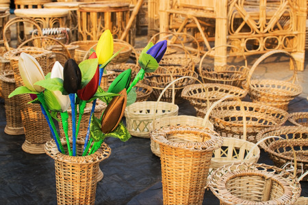 cane chair: Cloth made Tulip flower buds and Cane furniture handicrafts on display