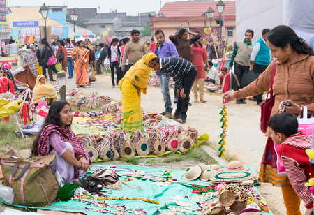 indian fair: KOLKATA, WEST BENGAL , INDIA - DECEMBER 12TH 2014 : Unidentified Indian women trading handmade jute dolls, handicrafts on during Handicraft Fair in Kolkata - the biggest handicrafts fair in Asia. Editorial