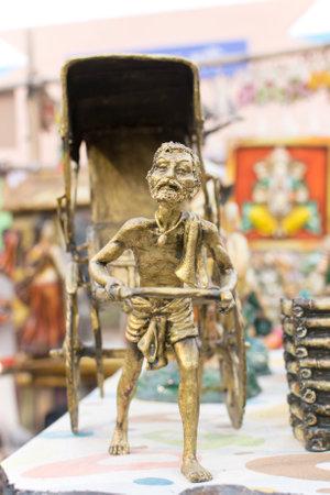 west bengal: KOLKATA, WEST BENGAL , INDIA - NOVEMBER 23RD 2014 : Miniature rickshaw puller, artwork, handicrafts on display during the Handicraft Fair in Kolkata - the biggest handicrafts fair in Asia.