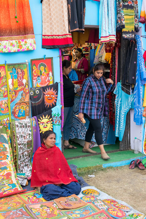 west bengal: KOLKATA, WEST BENGAL , INDIA - DECEMBER 12TH 2014 : Handmade painted clothes, handicrafts show during Handicraft Fair in Kolkata - the biggest handicrafts fair in Asia. Editorial