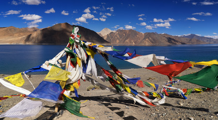 Buddhist prayer flags flying at Pangong tso (Lake). It is huge lake in the Himalayas situated at a height of about 4,350 m (14,270 ft). It is 134 km (83 mi) long and extends from India to Tibet.