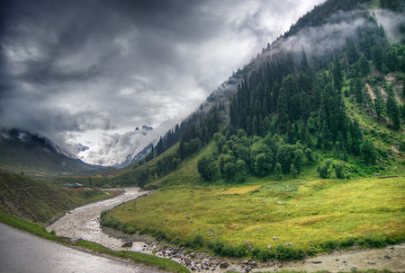 rain: storm clouds over mountains of ladakh, green valley sccenary,  Jammu and Kashmir, India