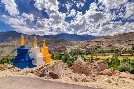 stupas: Three colourful buddhist religious stupas at Leh, Ladakh, Jammu and Kashmir, India Stock Photo