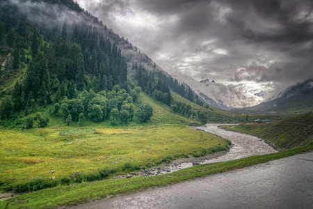 rain water: storm clouds over mountains and Indus river of ladakh, green valley sccenary,  Jammu and Kashmir, India