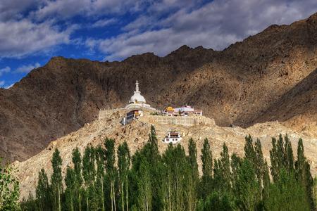 shanti: Shanti Stupa with view of Himalayan mountain and blue sky in background,Ladakh,Jammu and Kashmir, India