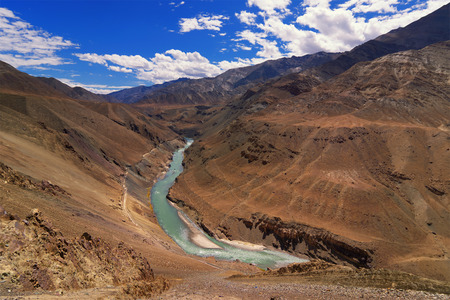 downstream: Beautiful Zanskar river flowing through rocks of Ladakh, Jammu and Kashmir, Ladakh, India, natural, landscape, scenic, waterbody, riverbank, aerial view, brown, rocks, downstream