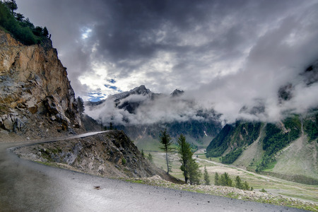 rain weather: storm clouds over mountains of ladakh green valley sccenary  Jammu and Kashmir India