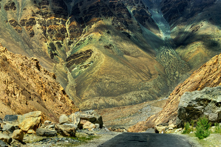 onwards: A concrete road towards beautiful rocky mountains and snow peaks of Himalaya Leh Ladakh Jammu and Kashmir India landscape natural scene travel