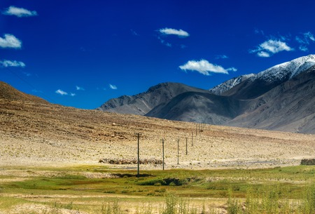 fade away: Electric posts fading away in rocky Himalayan mountains of Leh, Ladakh, Jammu and Kashmir, India
