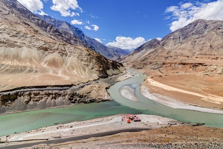 tourist spot: Scenic view of Confluence of Zanskar river from left and Indus rivers from up right - Leh, Ladakh, Jammu and Kashmir, India. Famous tourist spot of Ladakh for all seasons. landscape. Stock Photo