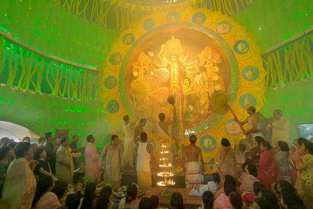 documentary: KOLKATA , INDIA - OCTOBER 1, 2014 : Priest praying to Goddess Durga, Durga Puja festival celebration. Biggest religious festival of Hinduism and Kolkatas Bengali Community. Documentary editorial.