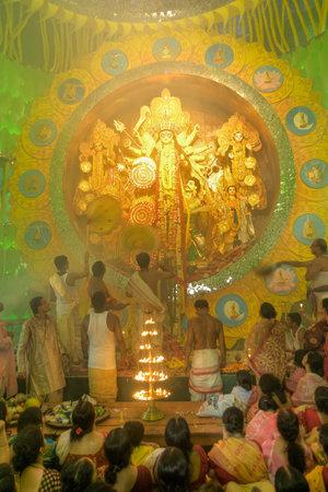 puja: KOLKATA , INDIA - OCTOBER 1, 2014 : Priest praying to Goddess Durga, Durga Puja festival celebration. Biggest religious festival of Hinduism and Kolkatas Bengali Community. Documentary editorial.