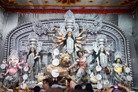 documentary: KOLKATA , INDIA - OCTOBER 2, 2014 : Durga idol at Puja festival. Biggest religious festival of Hinduism and local Bengali community, documentary editorial.