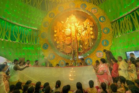 documentary: KOLKATA , INDIA - OCTOBER 1, 2014 : Priests carrying Sari Hindu dress for women for Goddess Durga , Durga Puja festival celebration. Biggest religious festival of Hinduism and Kolkatas Bengali Community. Documentary editorial. Editorial