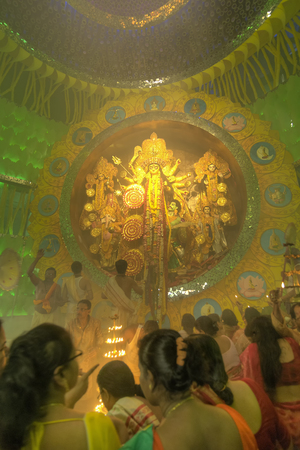 documentary: KOLKATA , INDIA - OCTOBER 2, 2014 : People enjoying inside Durga Puja Pandal decorated temporary temple. Biggest religious festival of Hinduism and local Bengali community, documentary editorial. Editorial