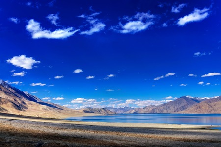 ridge of wave: Beautiful blue sky, clouds and mountains at Pangong tso Lake. It is huge lake in Ladakh, extends from India to Tibet. Leh, Ladakh, Jammu and Kashmir, India. Travellers paradise.