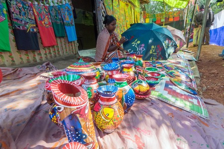 handicrafts: PINGLA, WEST BENGAL , INDIA - NOVEMBER 16TH 2015 : Colourful handicrafts are being prepared for sale in Pingla village by Indian rural woman worker. Handicrafts are rural Industry in West Bengal.