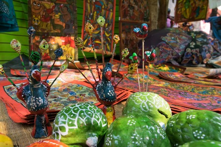 handicrafts:  Colourful clay made fruits and vegetables, handicrafts are being prepared in Pingla village. Handicrafts are rural Industry in West Bengal.