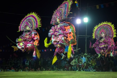 west bengal: BAMNIA, PURULIA, WEST BENGAL , INDIA - DECEMBER 23RD 2015 : Three dancers performing at Chhau Dance festival. It is a very popular Indian tribal martial dance performed at night amongst spectators.